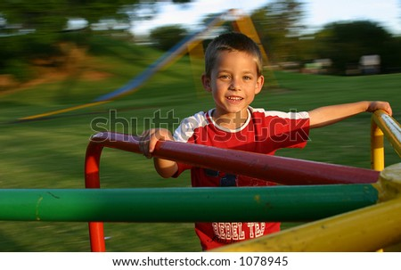 Young boy on playground - stock photo