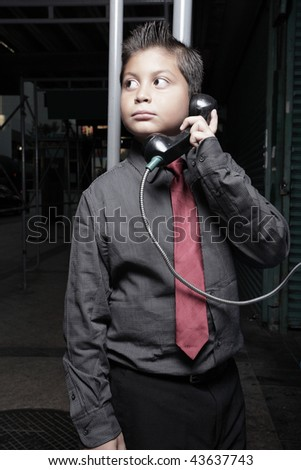 Young boy on the phone at night