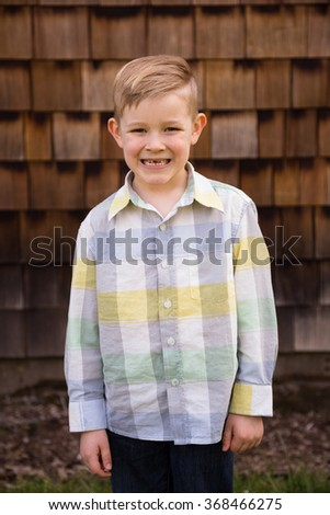 Young boy outdoors in a lifestyle portrait with natural light.