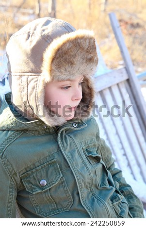 Young boy outside on a cold winters day - stock photo