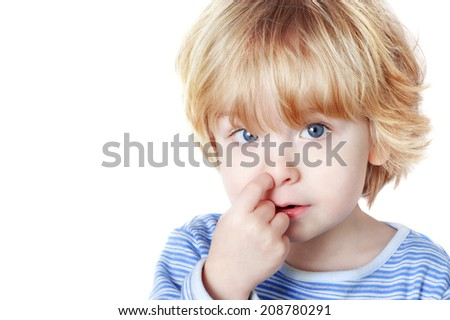 Young boy picking his nose - stock photo