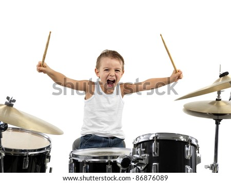 young boy play drum with energy - stock photo