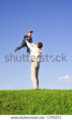 Young boy play with father - stock photo