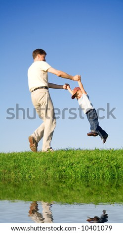 Young boy play with father near river. 12 - stock photo
