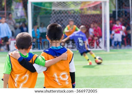Young boy player waiting for kick a ball, football soccer match for children - stock photo
