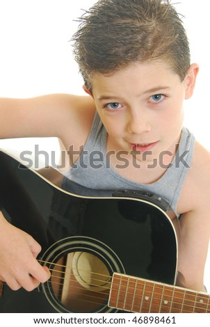 young boy playing acoustic guitar isolated on white. - stock photo