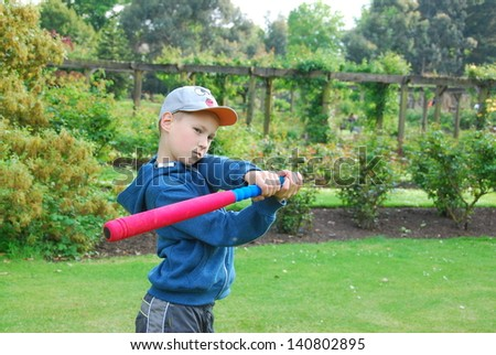 Young boy playing ball - stock photo