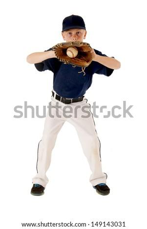 Young boy playing baseball staring at camera - stock photo