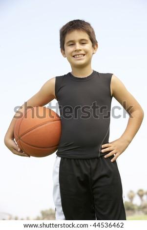 Young Boy Playing Basketball - stock photo
