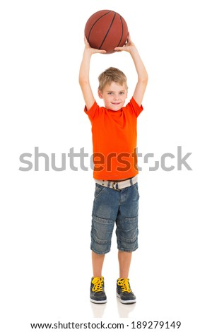 young boy playing basketball on white background - stock photo