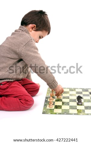 young boy playing chess - stock photo