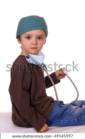 Young boy playing doctor. - stock photo