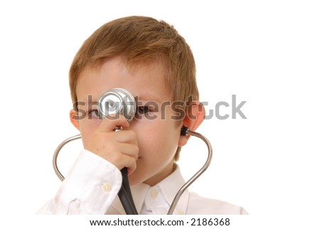 Young boy playing doctor wearing a stethoscope