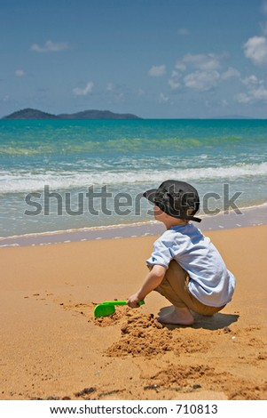 Young boy playing in the sand.