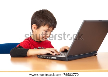 Young boy playing on laptop isolated on white background - stock photo