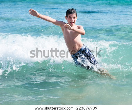 Young boy playing on tropical sea