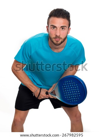 Young boy playing paddle tennis racket and blue shirt isolated on white background - stock photo