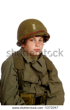 Young boy playing soldier.