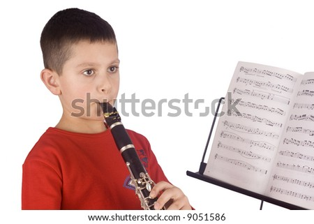Young boy playing the clarinet - stock photo