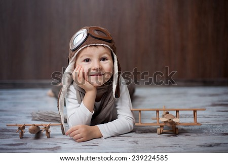 Young boy, playing with airplane, indoor - stock photo