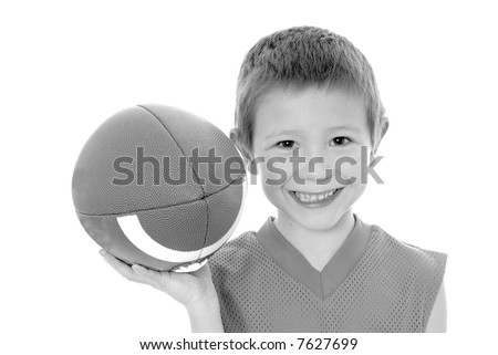Young boy playing with an American style football isolated - stock photo