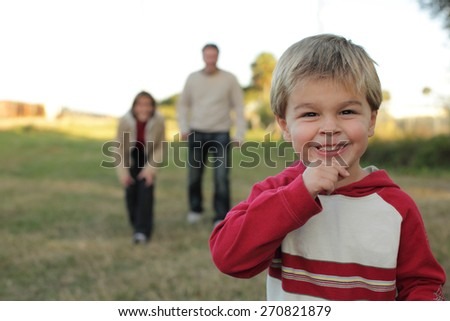 Young Boy Playing with Parents - stock photo