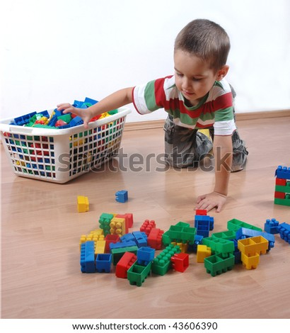 Young boy playing with plastic blocks