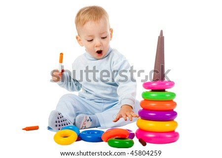 young boy playing with the educational toy isolated on white background - stock photo