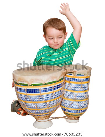 Young boy plays African bongo tom-tom drums, isolated on white background - stock photo