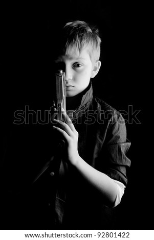 young boy plays at being a spy