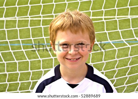 young boy plays soccer and enjoys it - stock photo
