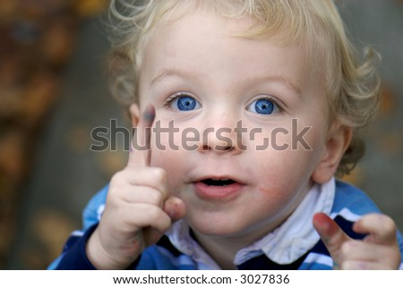 Young boy pointing - stock photo