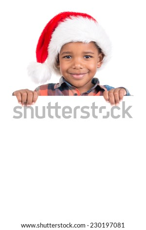 Young boy portrait in Santa's hat with white board isolated in white - stock photo
