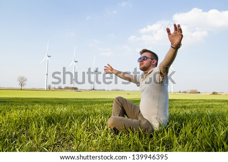 Young boy posing in field - stock photo