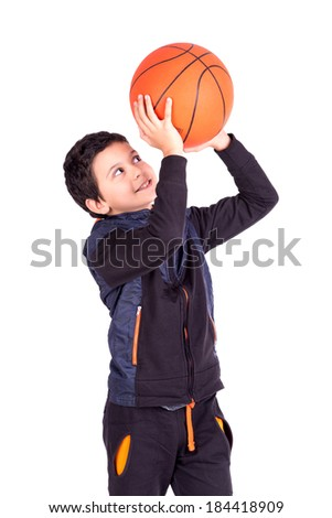 Young boy posing with a basketball ball isolated in white