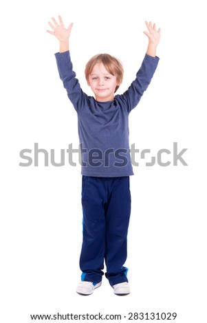 Young boy posing with raised hands isolated in white - stock photo