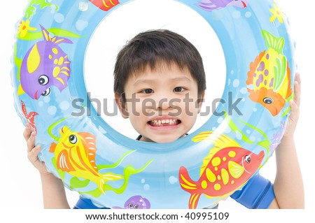 young boy posing with swim float - stock photo