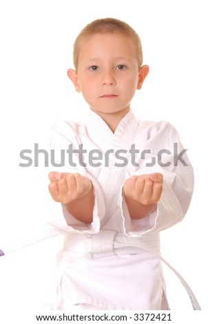 Young boy practicing karate isolated on white
