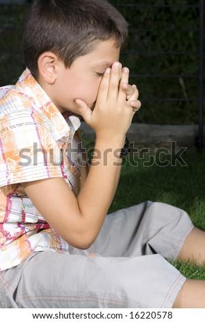 Young boy praying evening - stock photo
