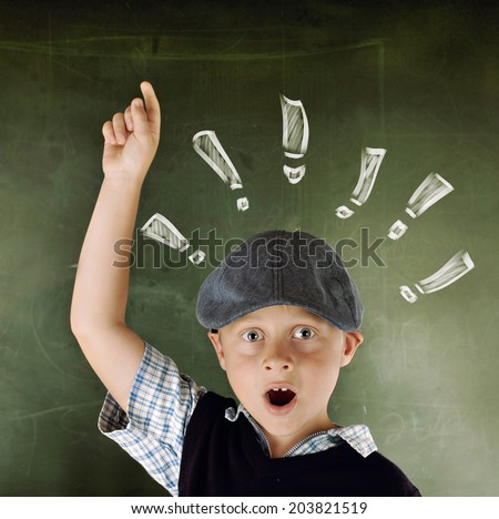 Young Boy preparing for school - stock photo