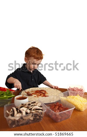 Young boy preparing homemade pizza isolated on white