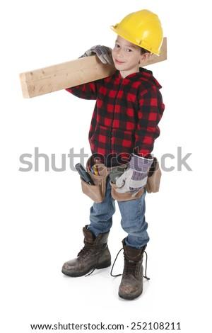Young boy pretending to be a carpenter - stock photo