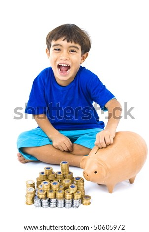 Young boy putting a coin in the pigbank - stock photo