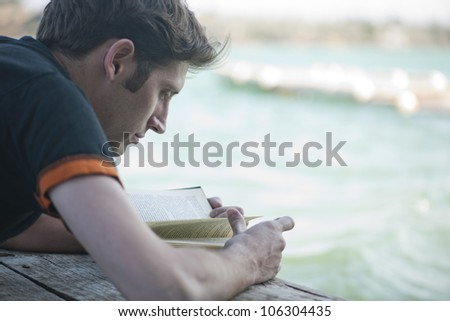Young boy reading in a pie - stock photo