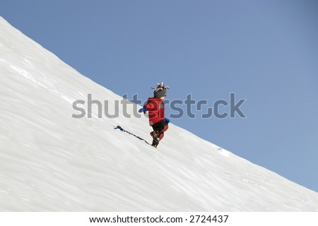 Young Boy running down a snowy Hill