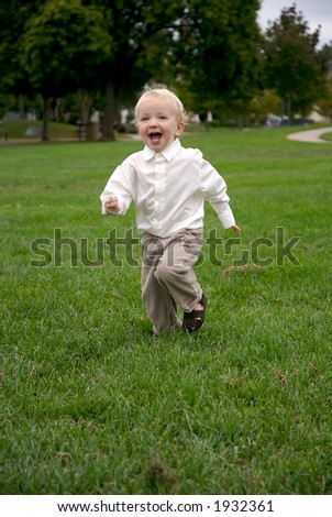 young boy running in park - stock photo