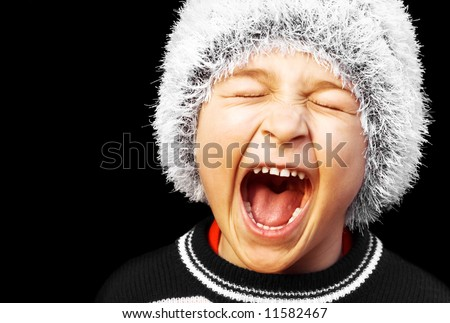 Young boy screaming - stock photo