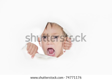 young boy shouting loudly through hole in paper - stock photo