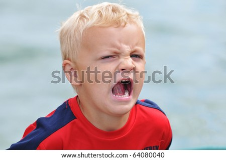 Young Boy Shouts in Anger - stock photo