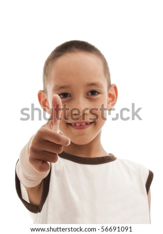young boy showing OK isolated on white